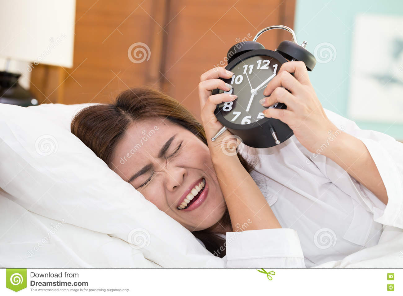Asian Woman Lying In Bed Suffering From Alarm Clock Sound Not E Stock Photo - Image -3490
