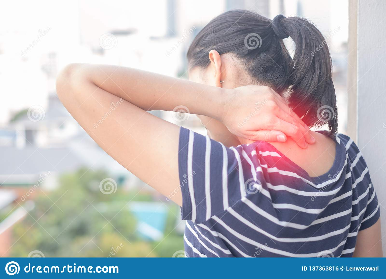 Asian Woman with muscle injury having pain in her neck.