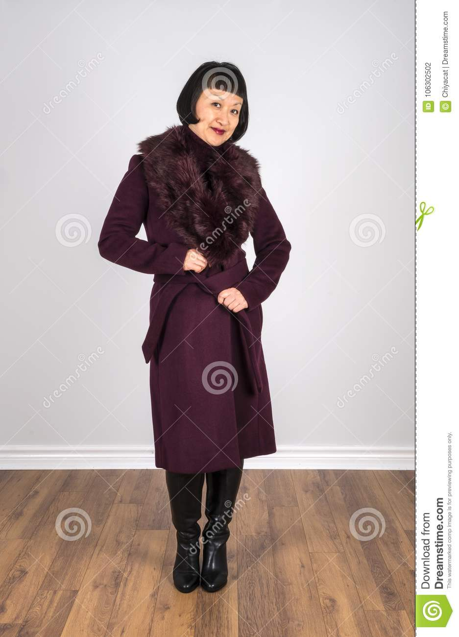 c13a16728a962 Asian Woman with Short Black Hair Wearing a Burgundy Colored Wool Coat 2
