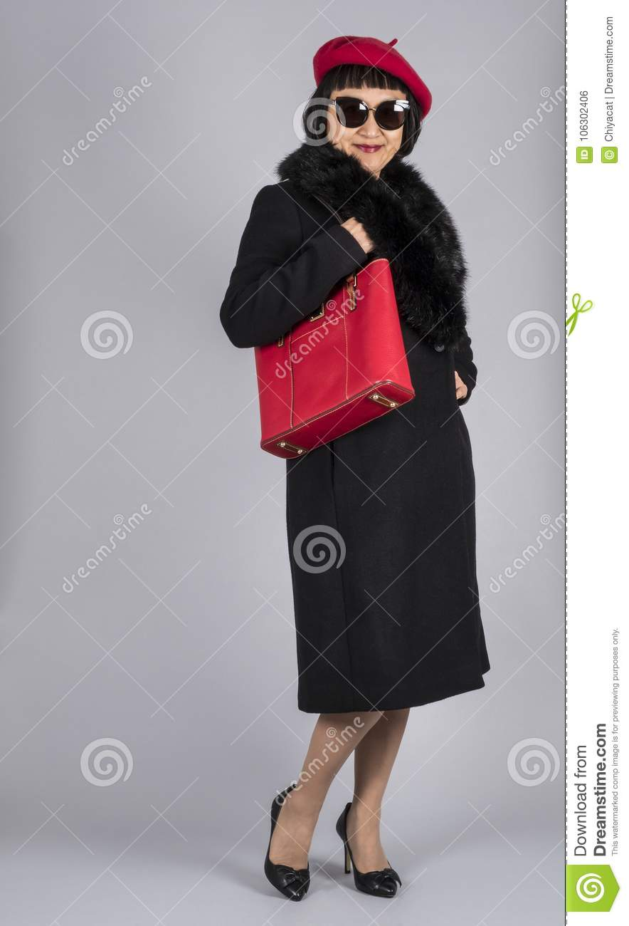f4b41dae2b2d2 Asian Woman with Short Hair Wearing a Red Beret Hat and Black Wool Coat