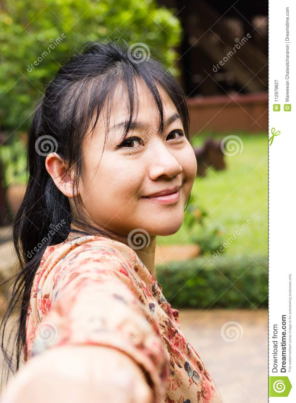 Asian women smiling, close-up face long hair Asian lady in brown