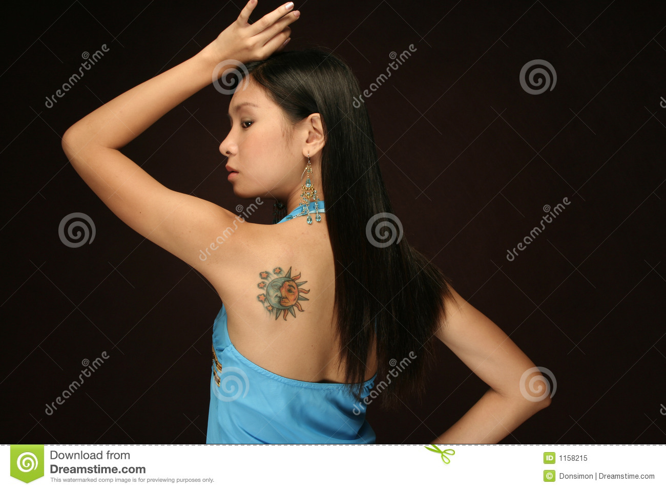 Asian Woman Sun and moon tattoo on shoulder
