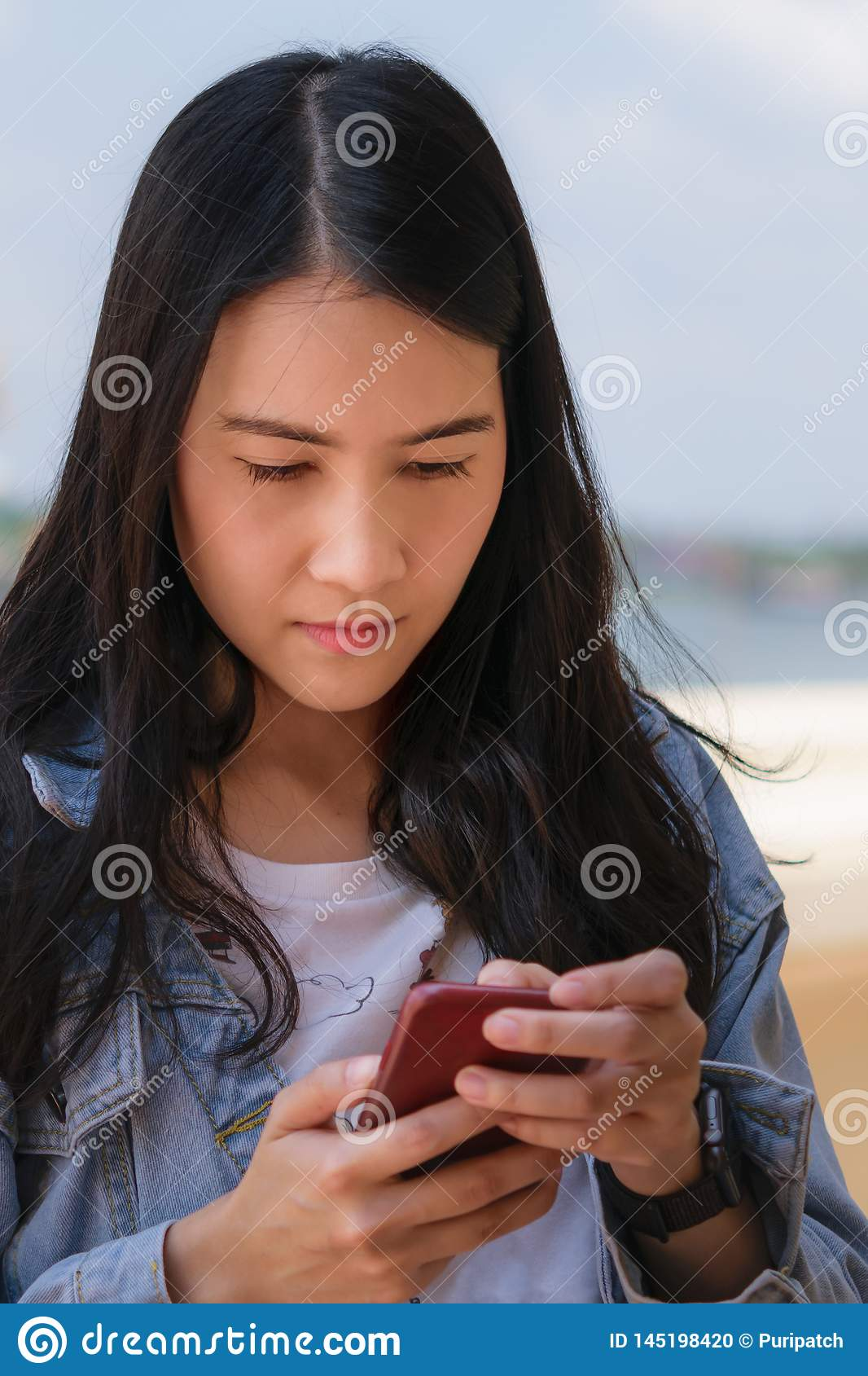 Asian woman is using smart phone