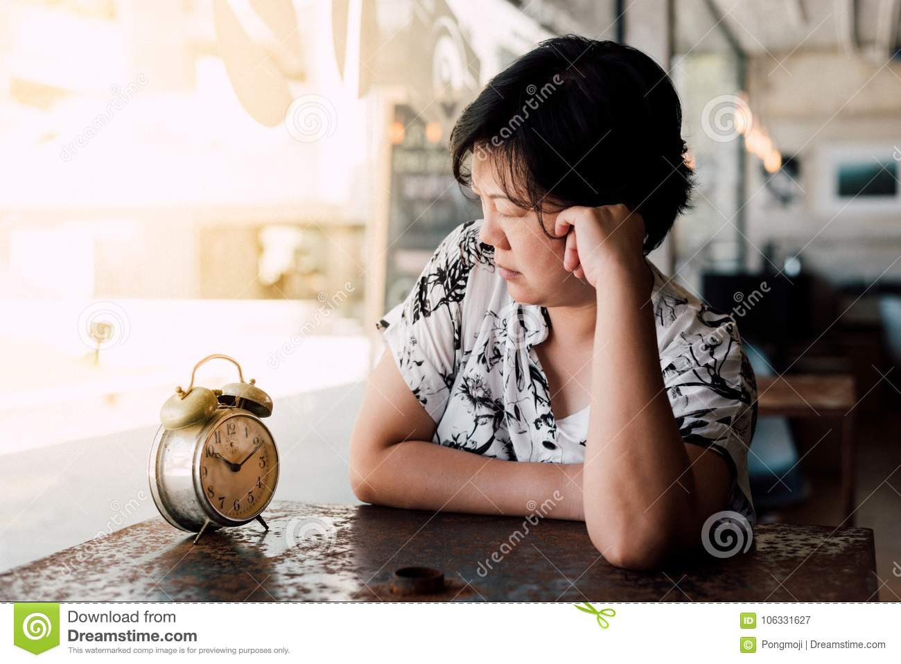 Asian Woman Waiting In Coffee Shop Cafe With Clock Stock
