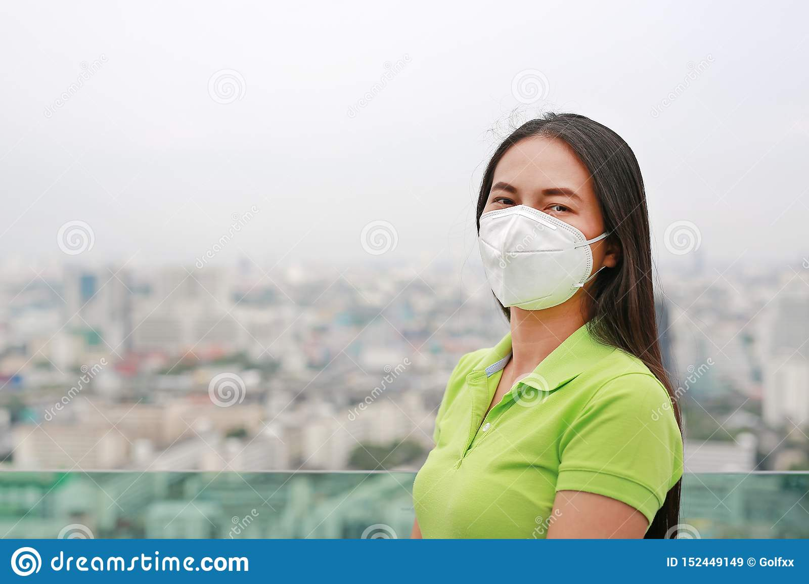 Asian woman wearing a protection mask against PM 2.5 air pollution in Bangkok city. Thailand