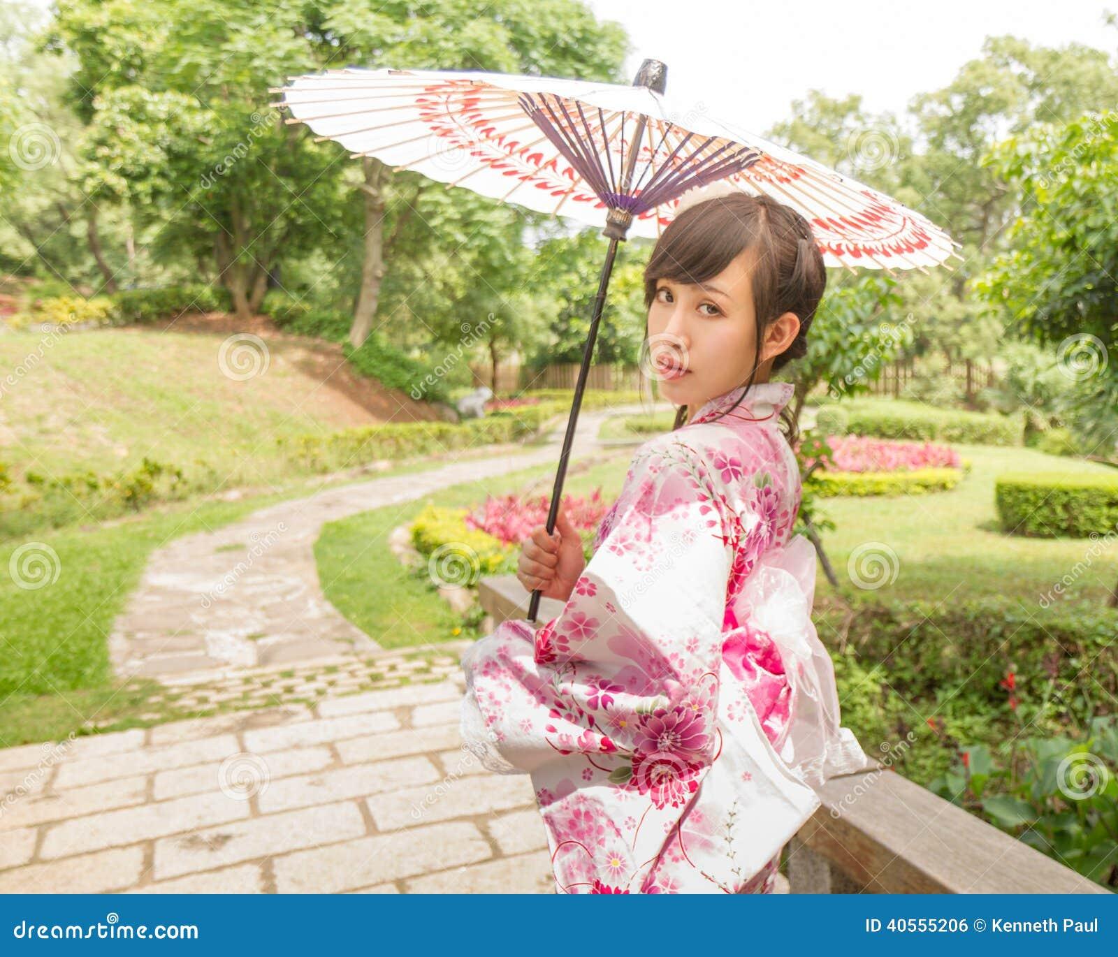 12f26c1e1 Asian Woman Wearing A Yukata And Holding An Umbrella In Japanese ...