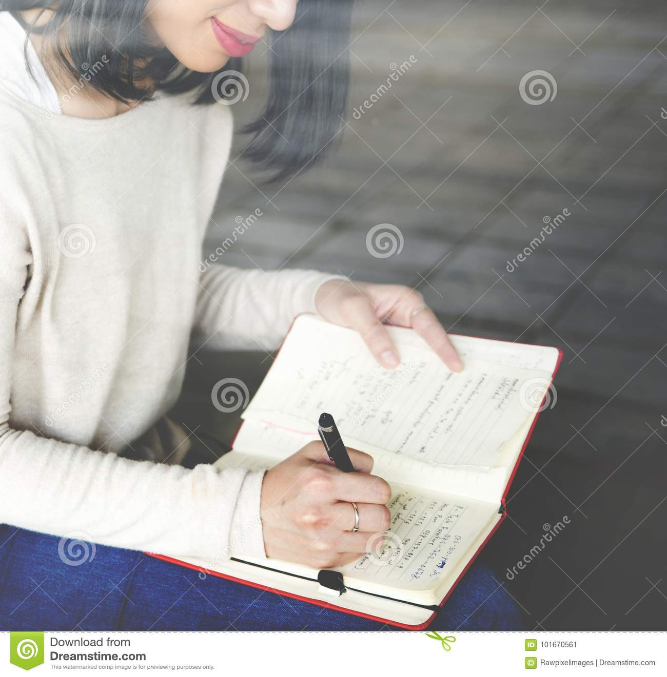 Asian woman writing notes concept