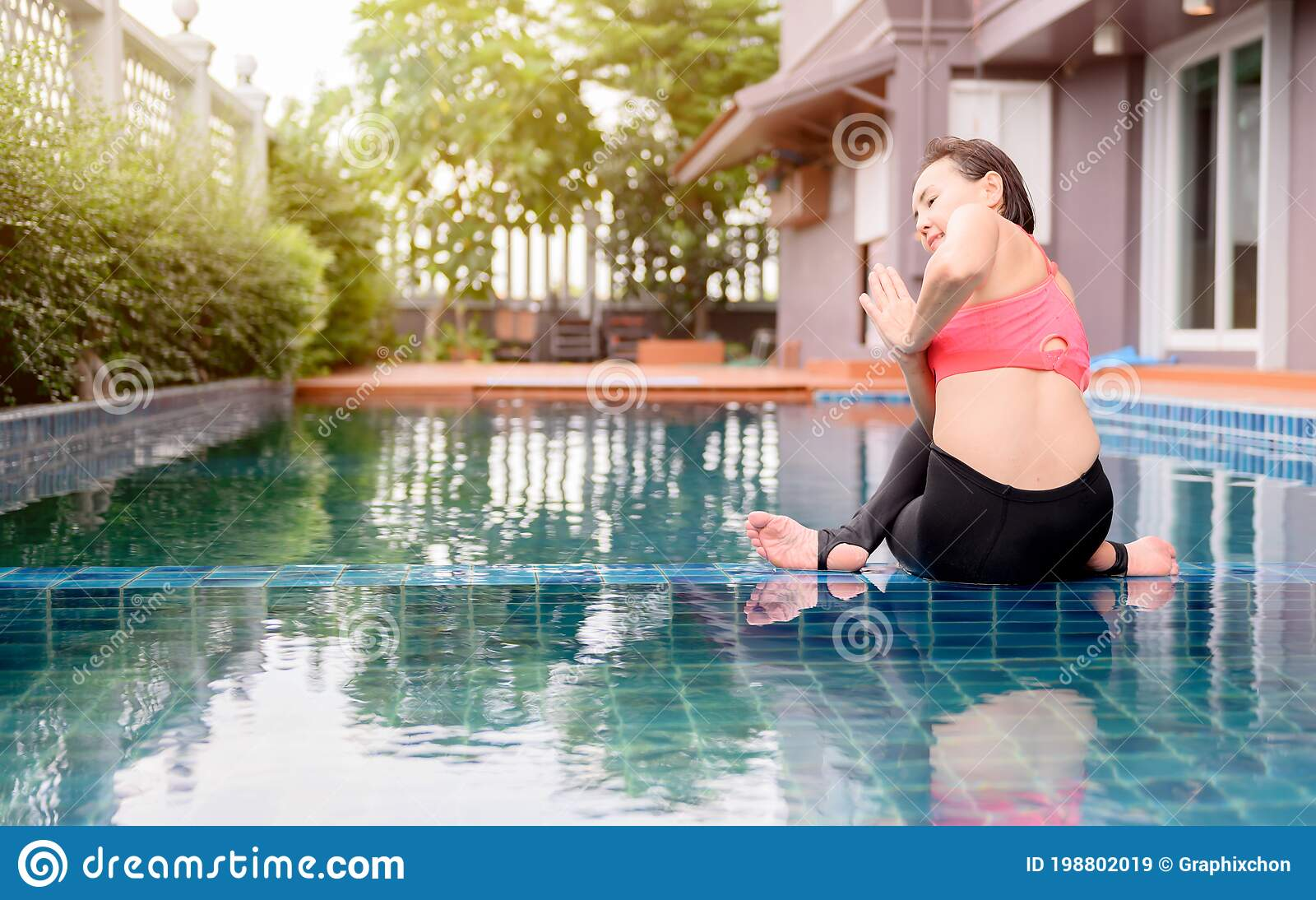 Asian Woman Yoga Breathing And Meditation Alone At Swimming Pool At Home Outdoor Exercise And Workout For Healthy Stock Image Image Of Mudra Fitness 198802019