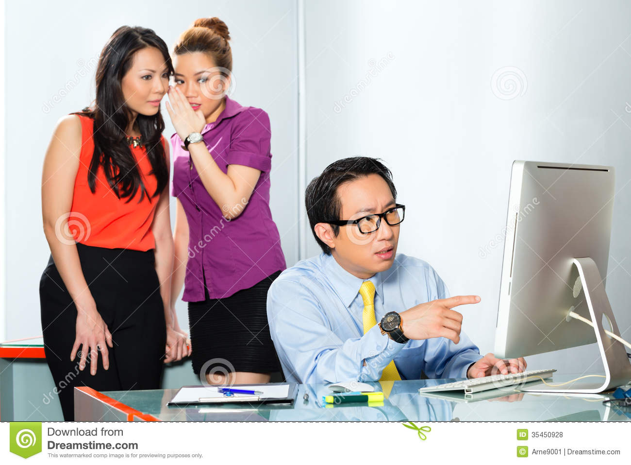 Asian Women Bullying Colleague In Office Stock Photo