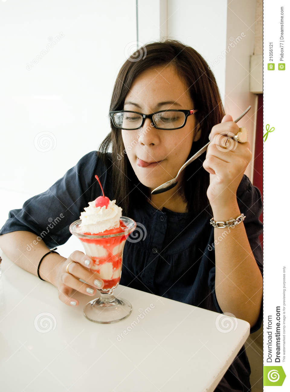 Asian women eating ice cream stock image image 21056121 for Japanese eating table