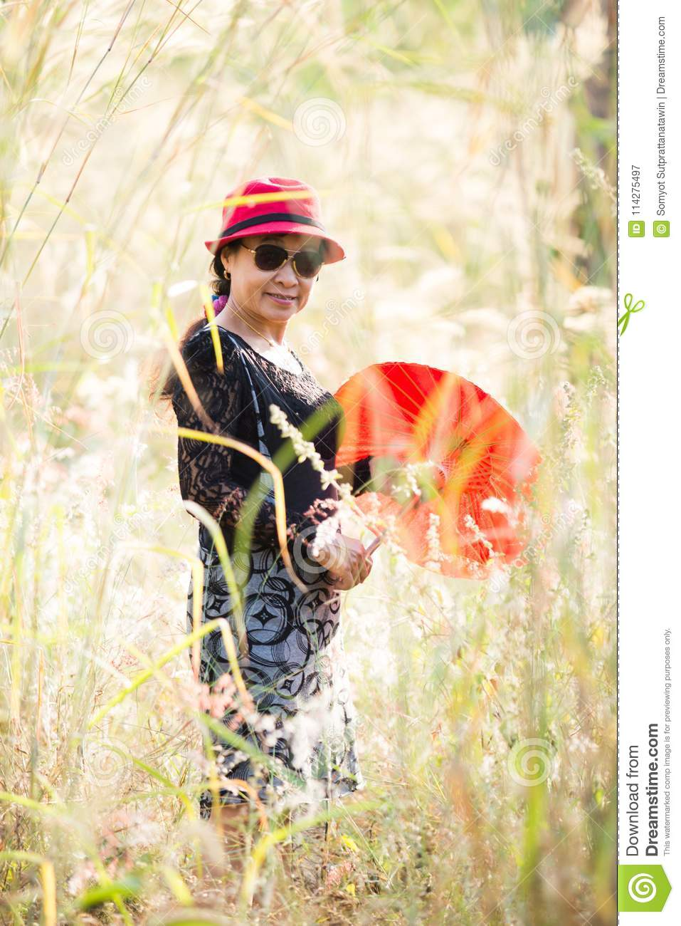 Asian women portrait with red umbrella
