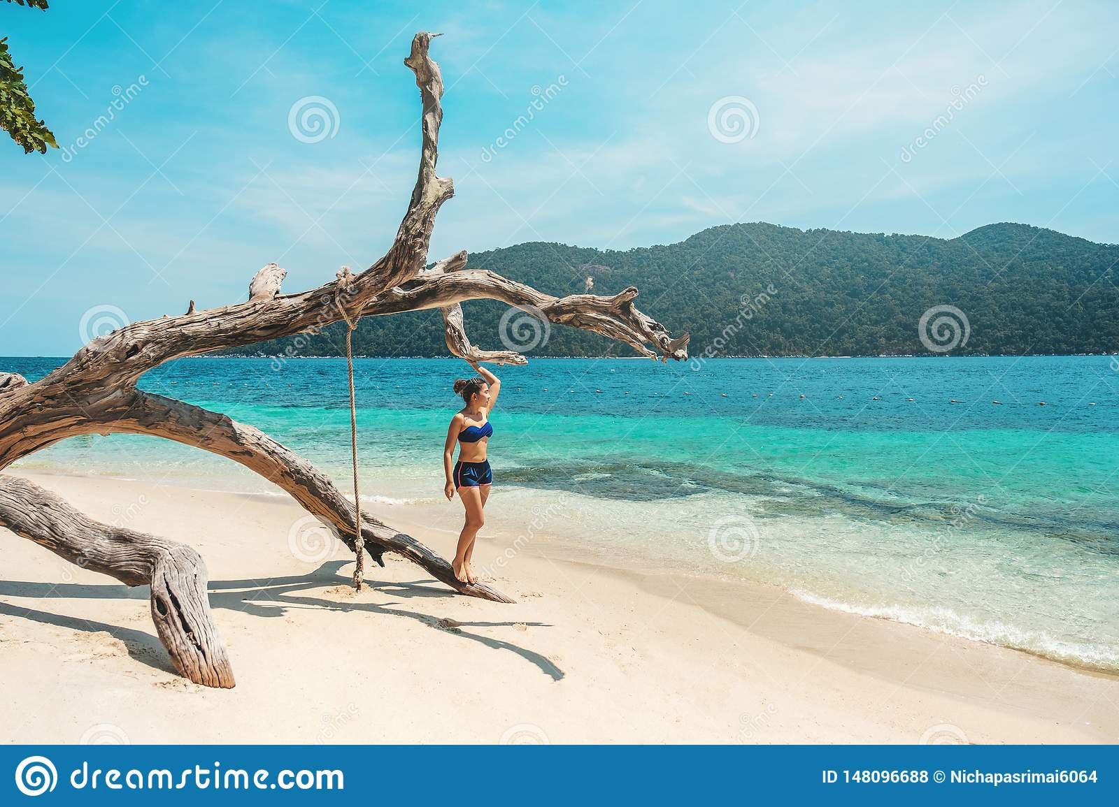 Asian women relaxing in summer holiday on beach