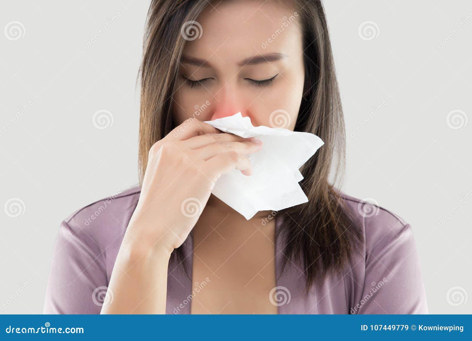 Asian Women In Satin Nightwear Feeling Unwell And Sneeze Against