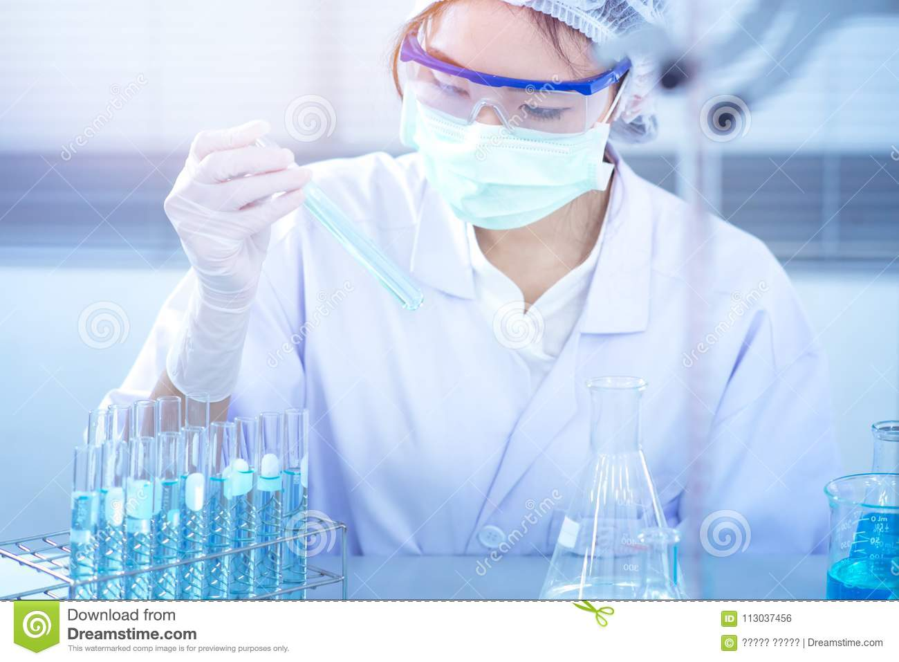 Asian women scientist with test tube making research in clinical  laboratory.Science, chemistry,