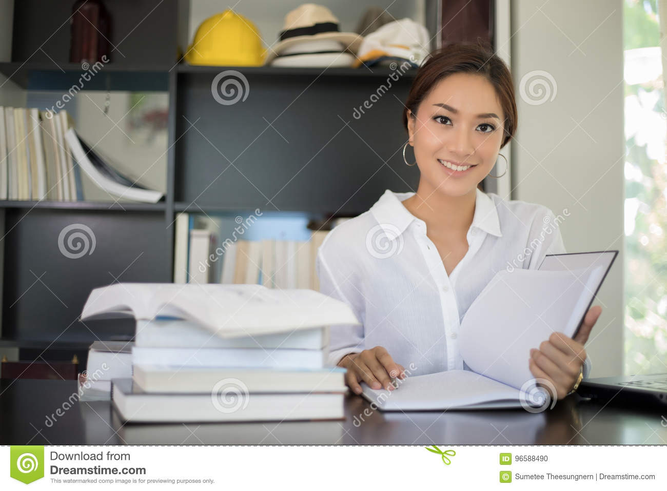 Asian women student smiling and reading a book for relaxation