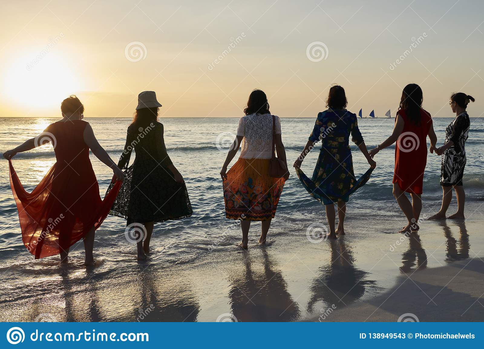 6 Asian women watching the sunset on Boracay island