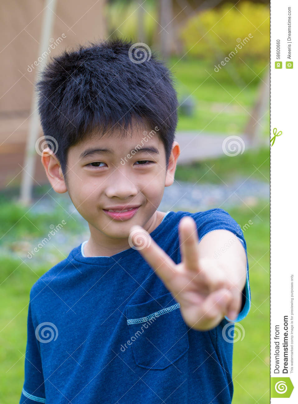 A Cute Asian Thai Young Boy With Thumb Up