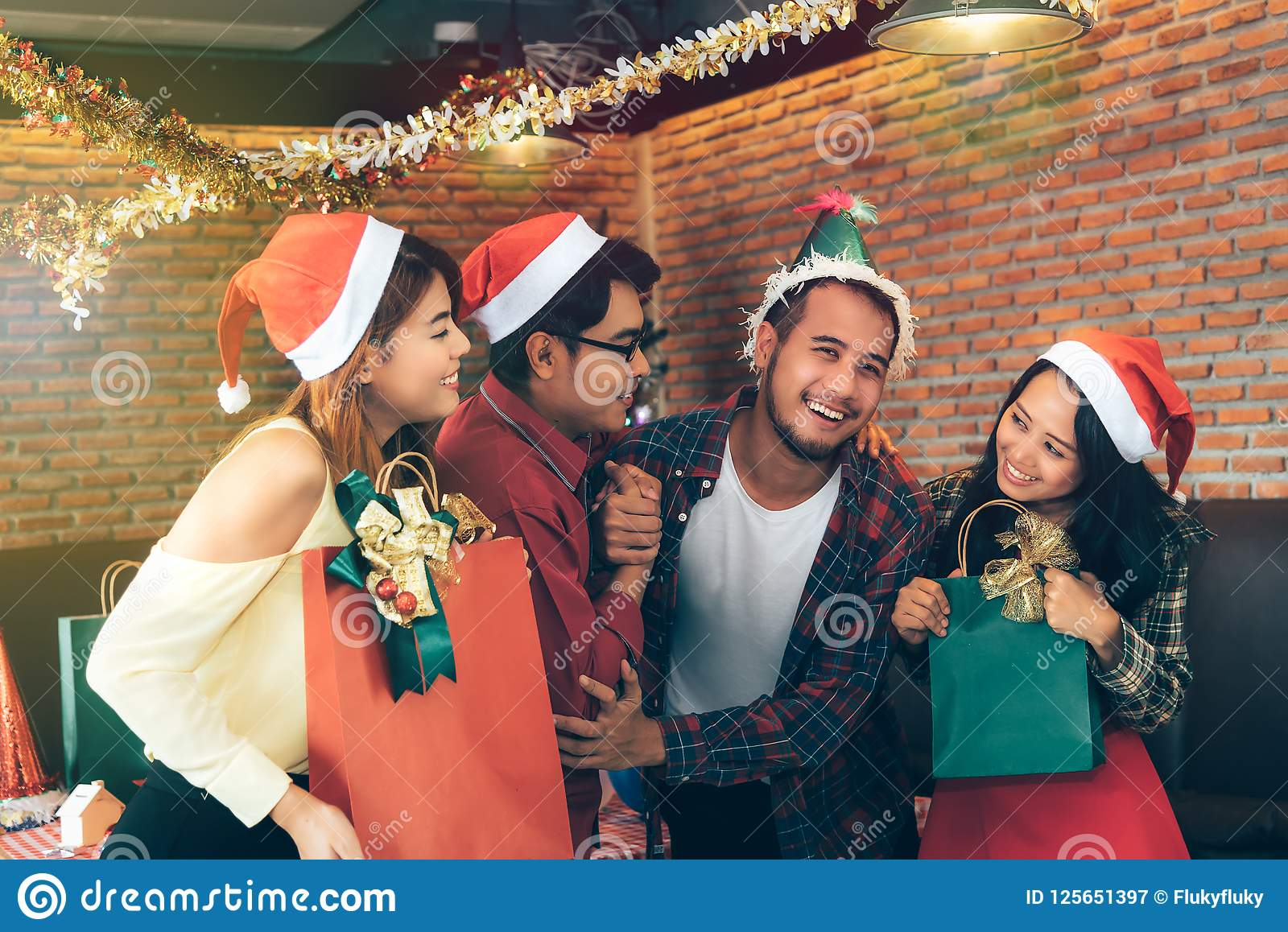 Asian young people enjoy Christmas parties on their holidays.