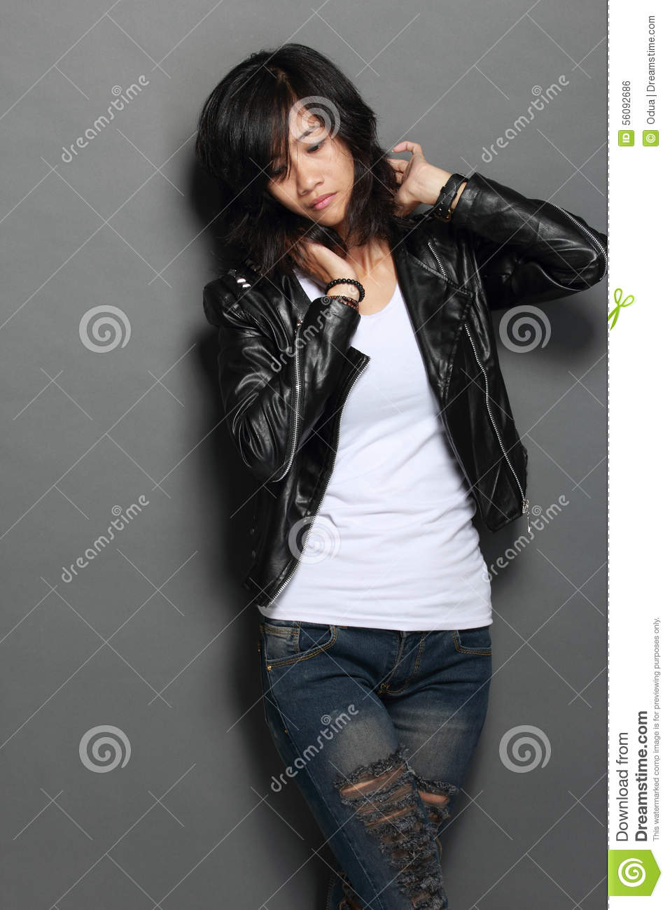 Asian Young Woman In Black Leather Jacket On Gray -1701