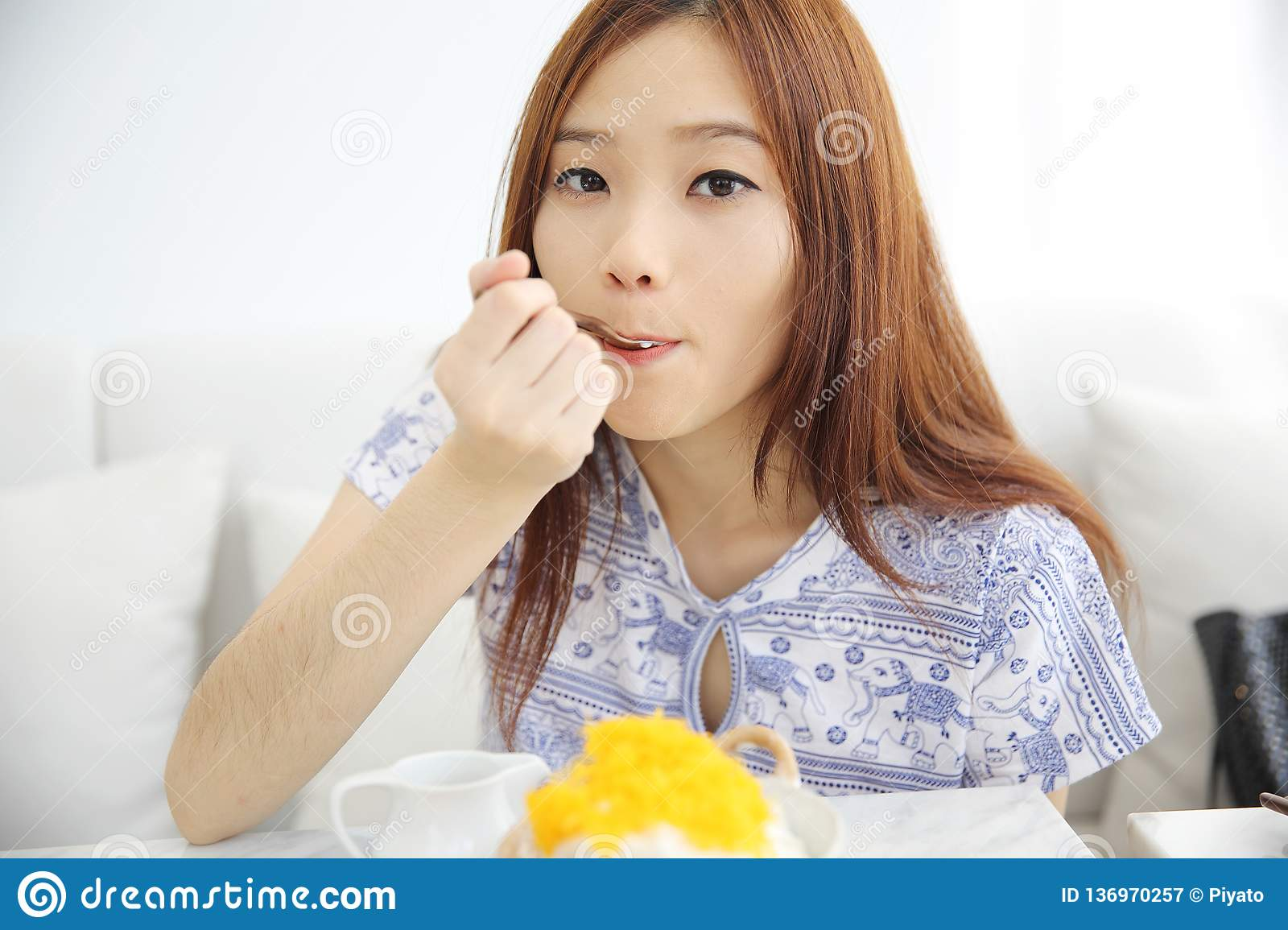 11645678f Asian Young Woman Drinking Iced Green Tea Latte In White Coffeeshop ...