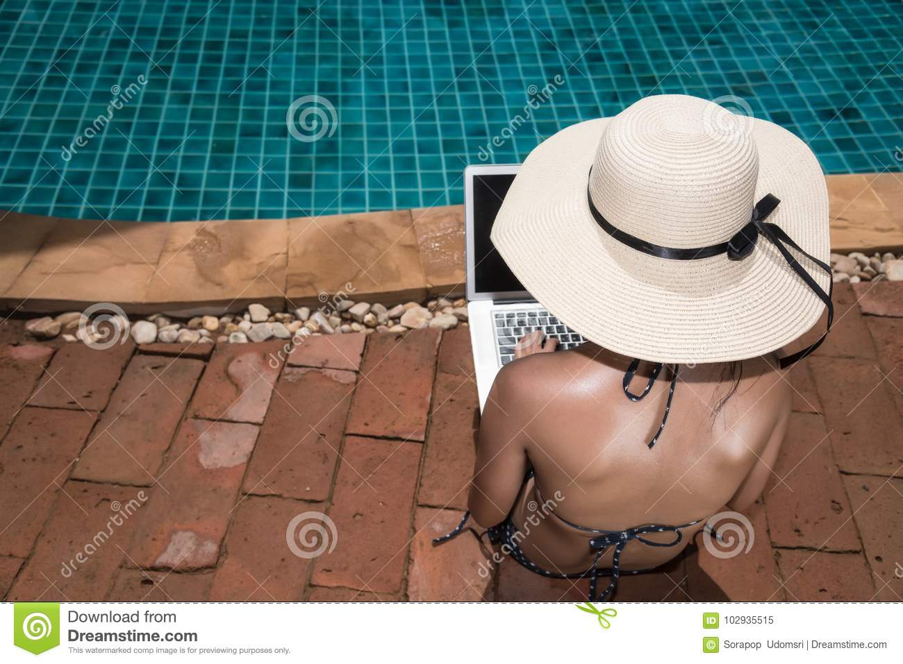 Asian Young Woman Using Her Laptop With Big Hat On Poolside Edge ... 67b15a358ad2
