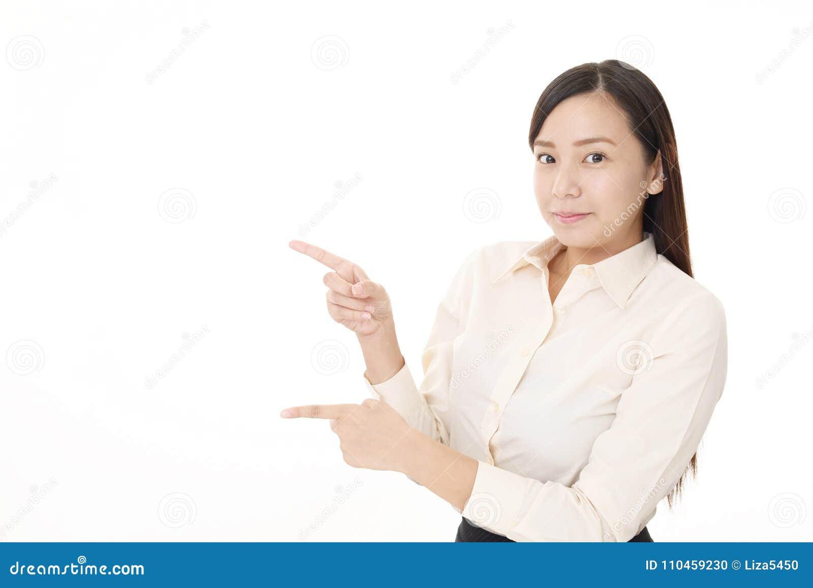 Asiatisk pekande kvinna