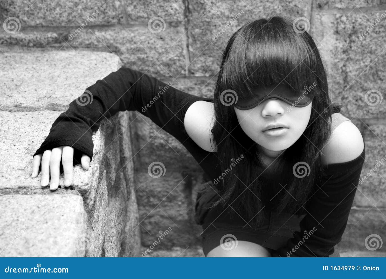 Asiatiskt blind- flickaslitage