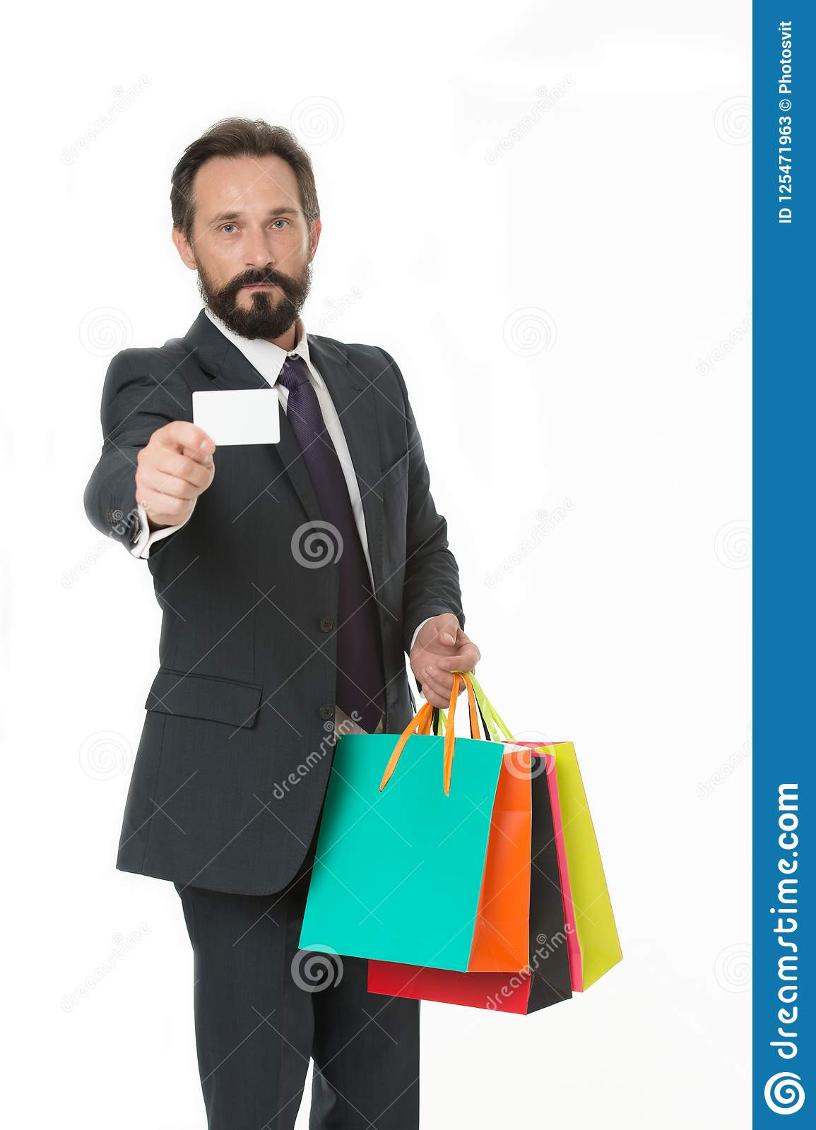 Ask deliver your purchases. Businessman formal suit holds bunch paper bags while show business card. Man bearded