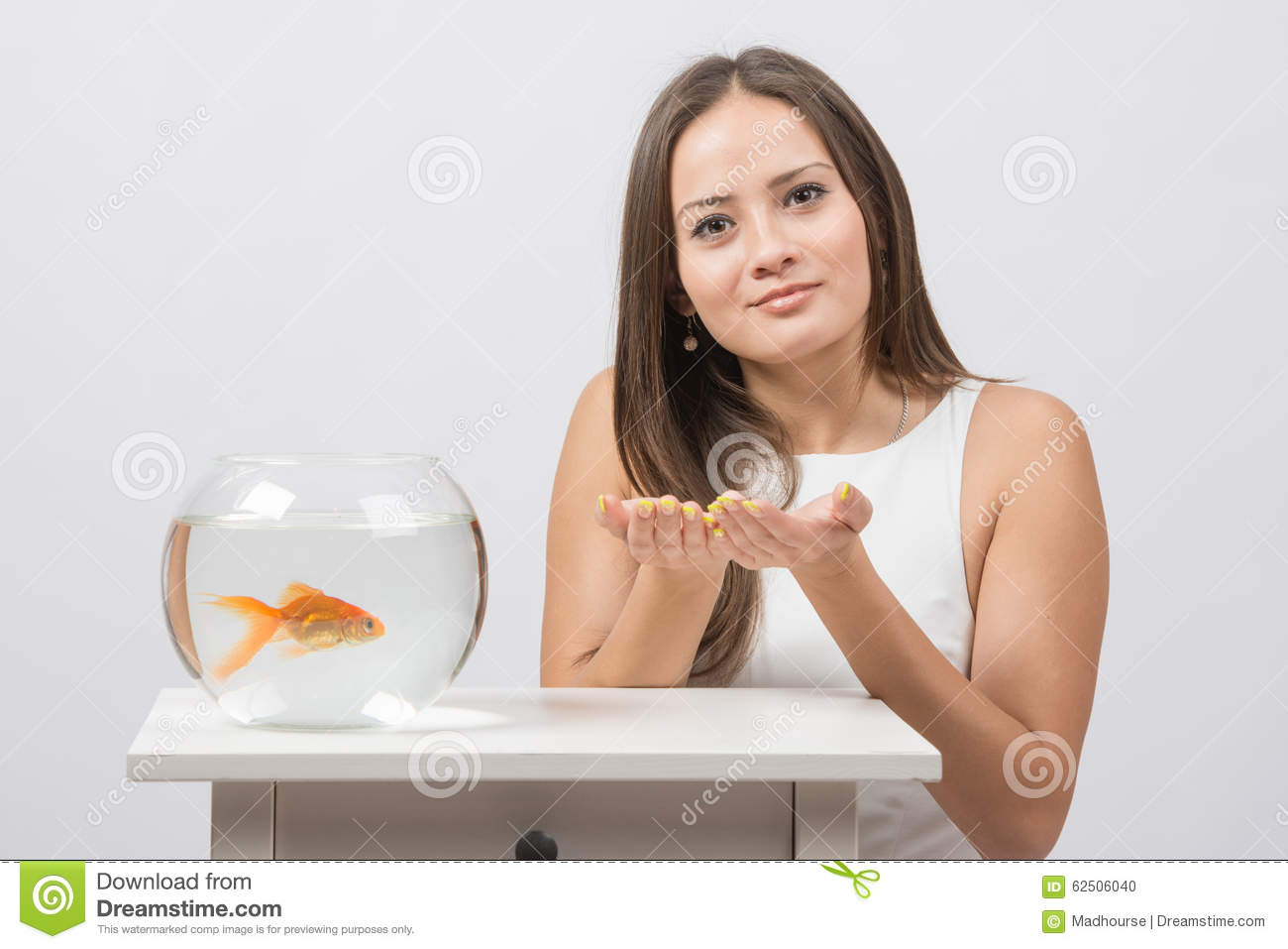 Download She Asks To Fulfill The Desire To Have A Goldfish In An Aquarium Stock Photo - Image of dreams, brown: 62506040