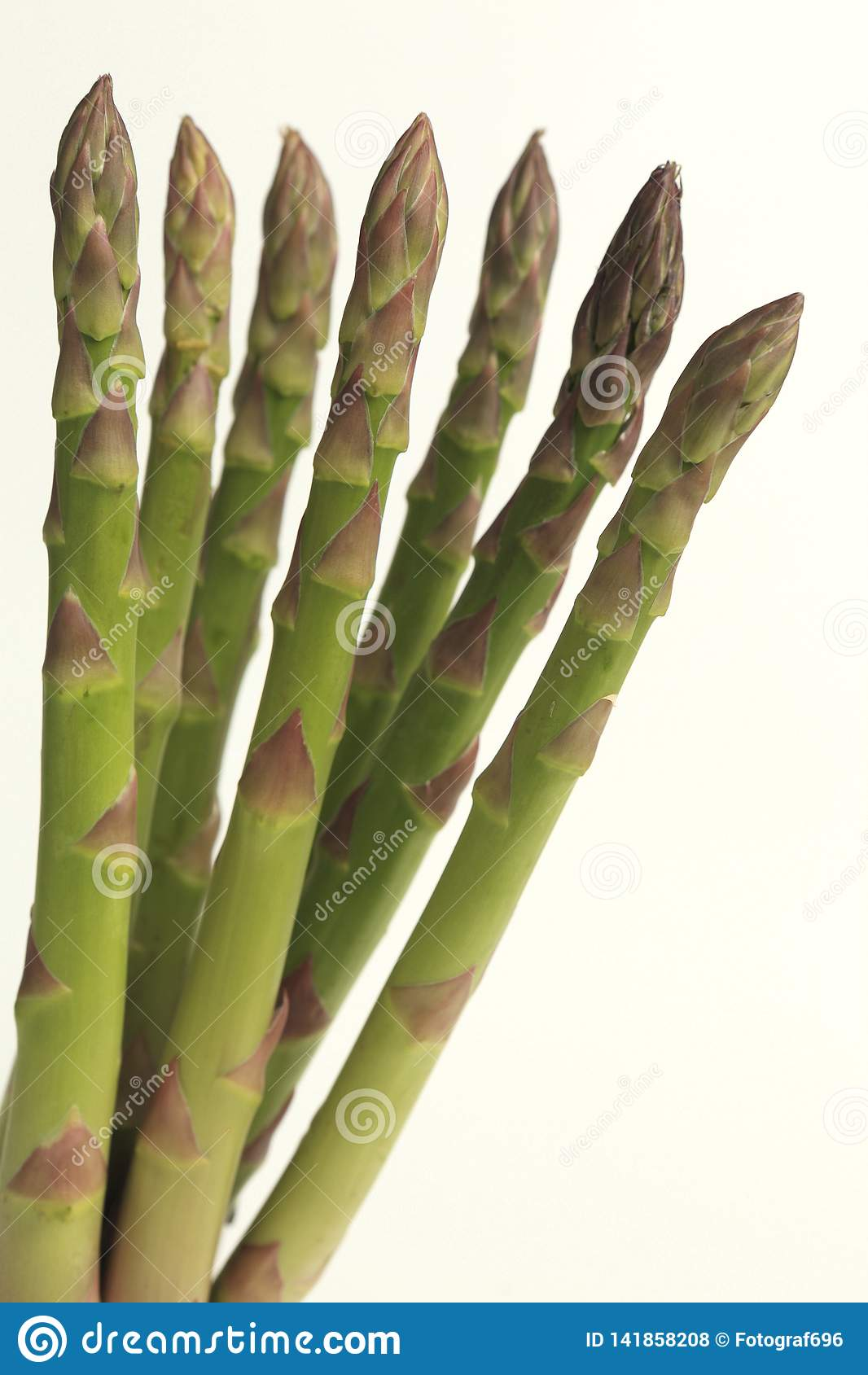 7 asparagus against white. Close up.