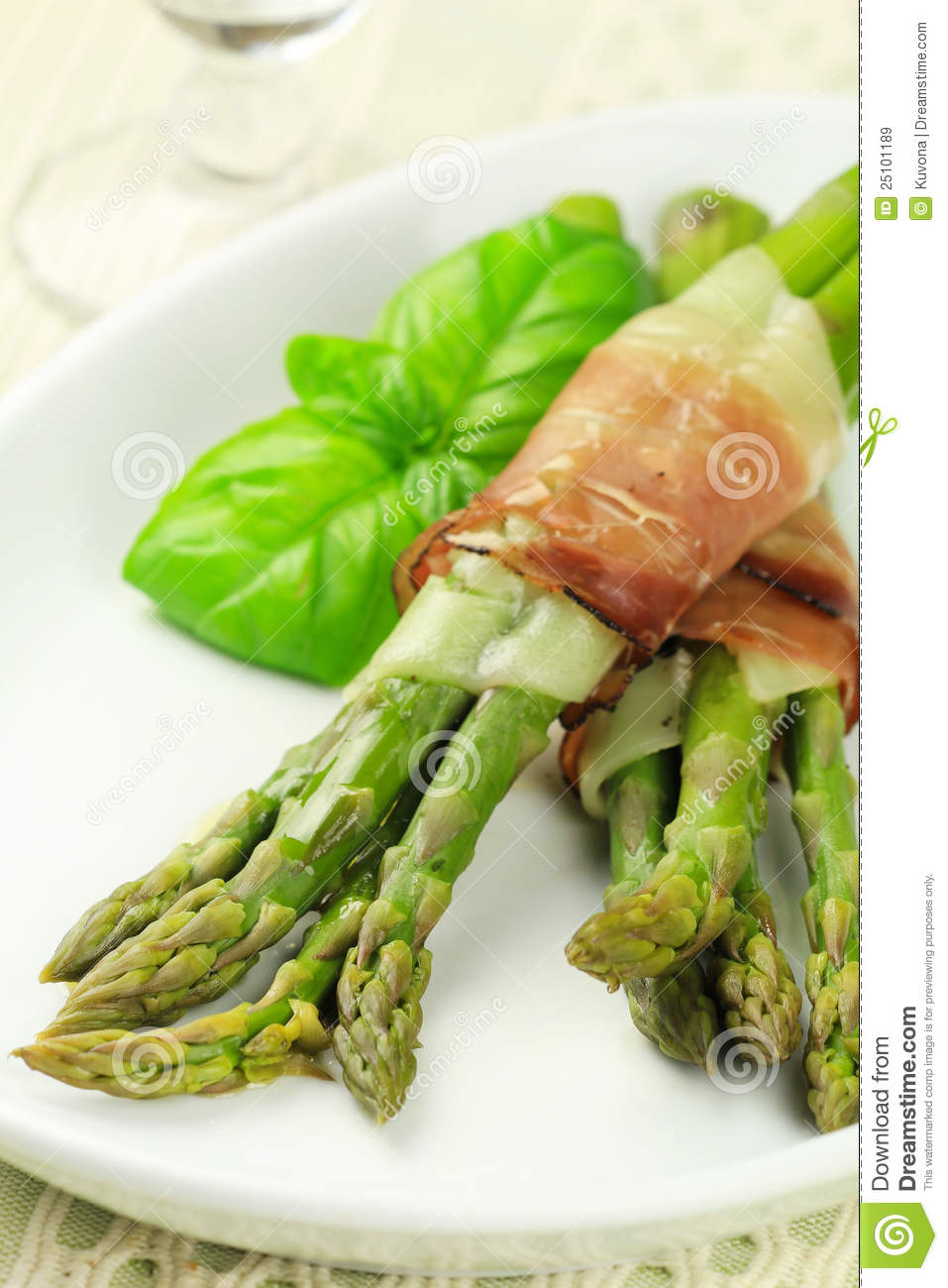 ... cooked green asparagus with cheese and South Tyrolean smoked bacon