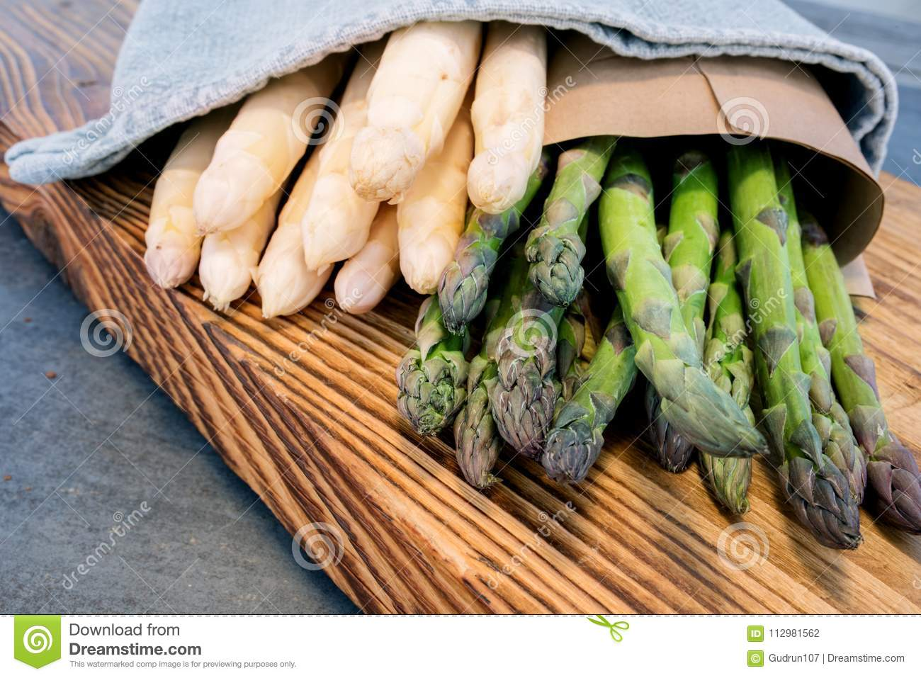 Asparagus tied on a wooden board