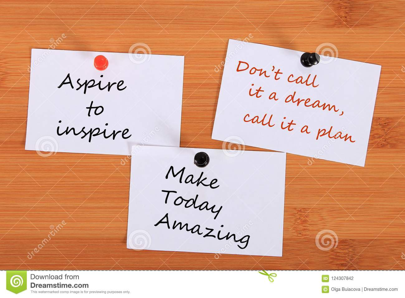 `Aspire to inspire`. `Don`t call it a dream, call it a plan.` `Make Today Amazing`. Note pin on the bulletin board.