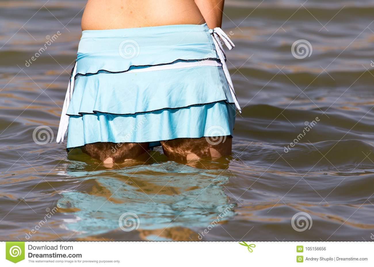 girl in the lake on the beach