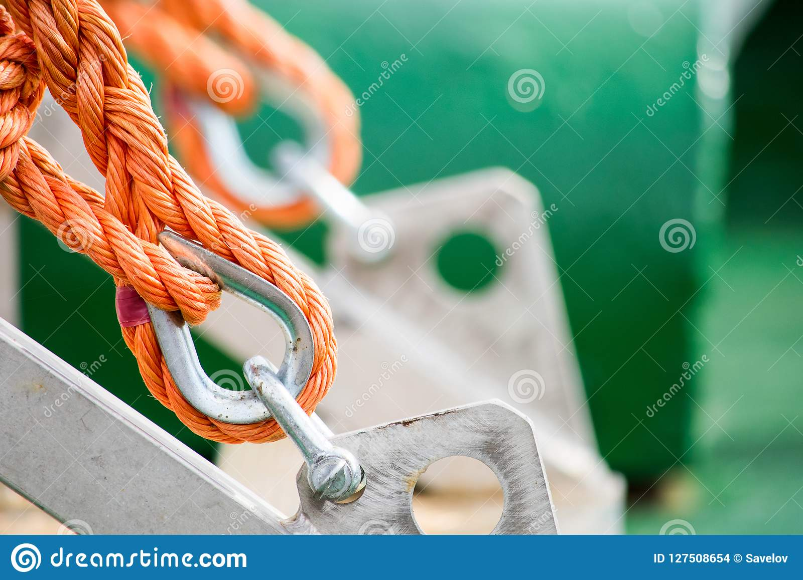 Asseguração de uma corda alaranjada
