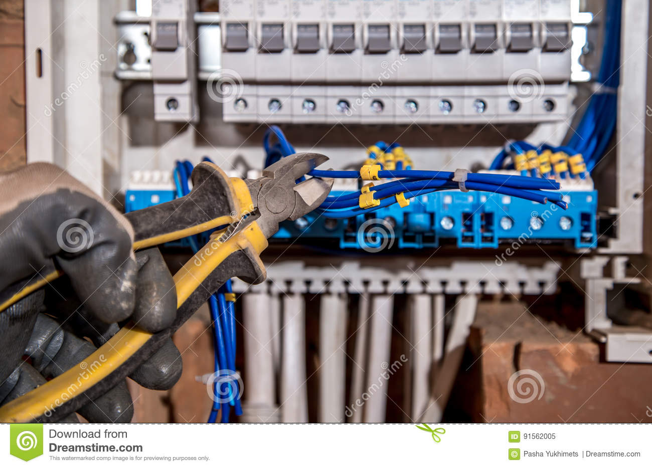 The Assembly Of Electrical Panel Electrician Job A Robot With Circuit Breaker Wiring Download Wires And