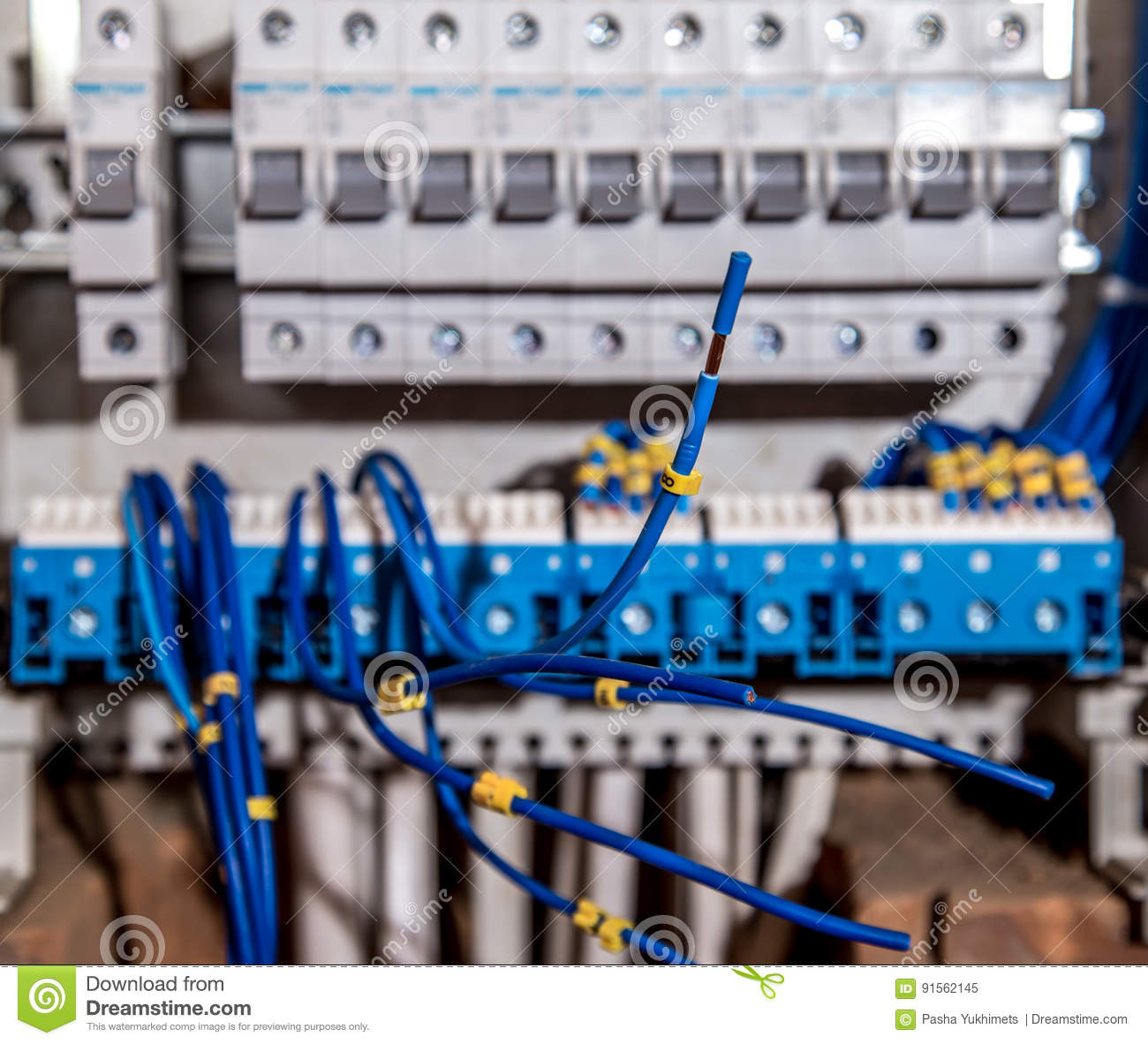 The Assembly Of Electrical Panel Electrician Job A Robot With Wiring Circuitbreaker Electricalpanel Wires And Circuit Breakers Tools