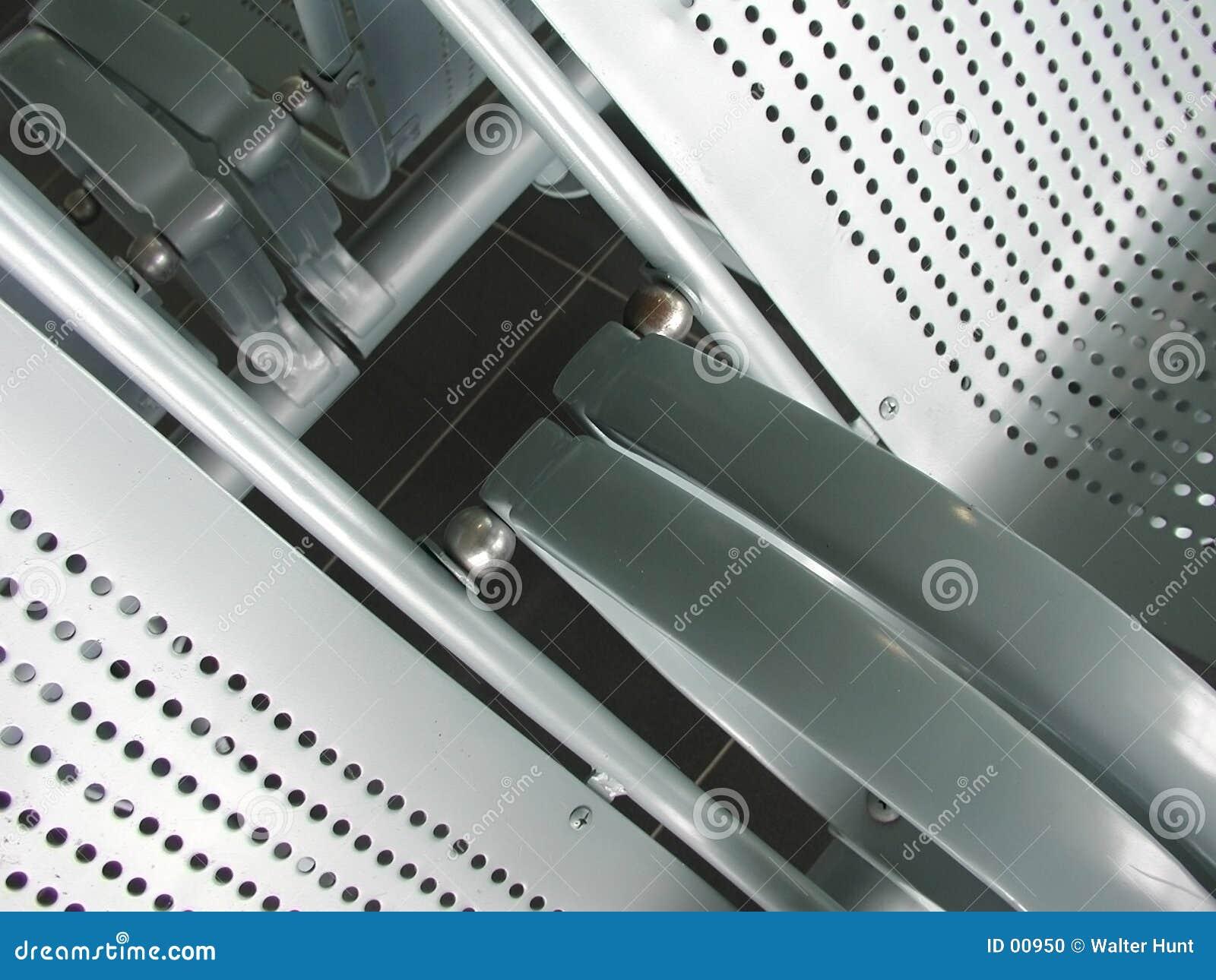 Assentos do aeroporto do metal