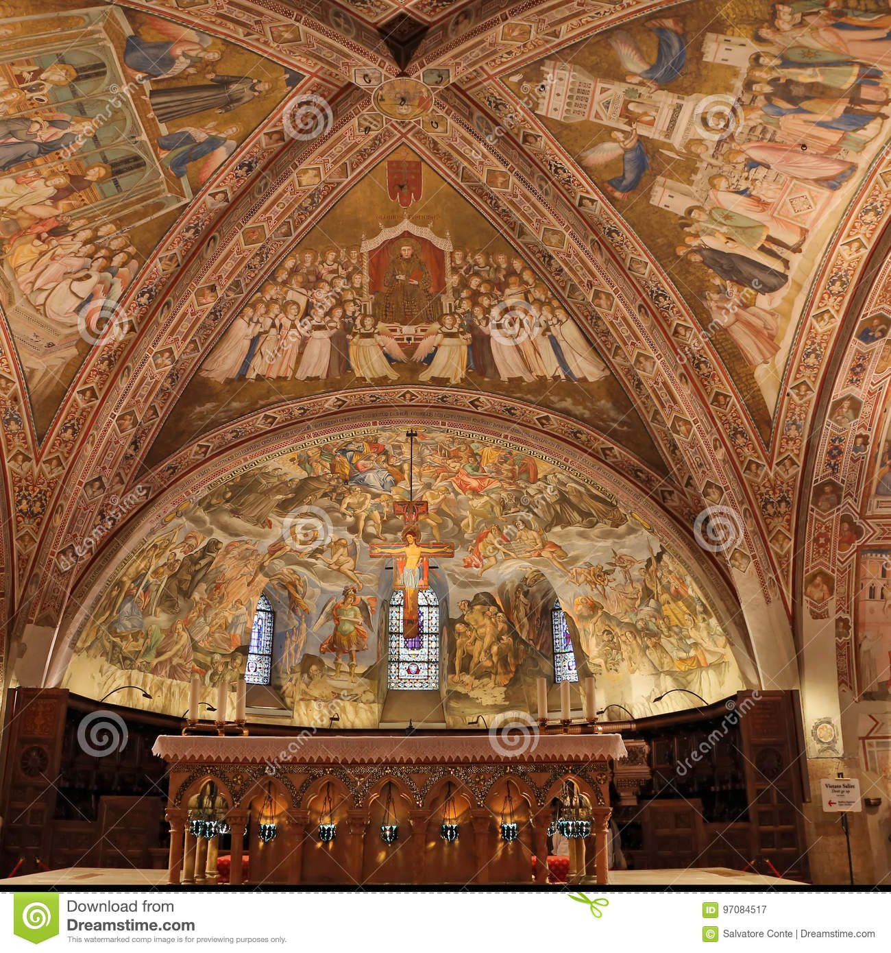 Interior Famous Basilica of St. Francis of Assisi Basilica Papale di San Francesco with Lower Plaza at sunset in Assisi, Umbria,