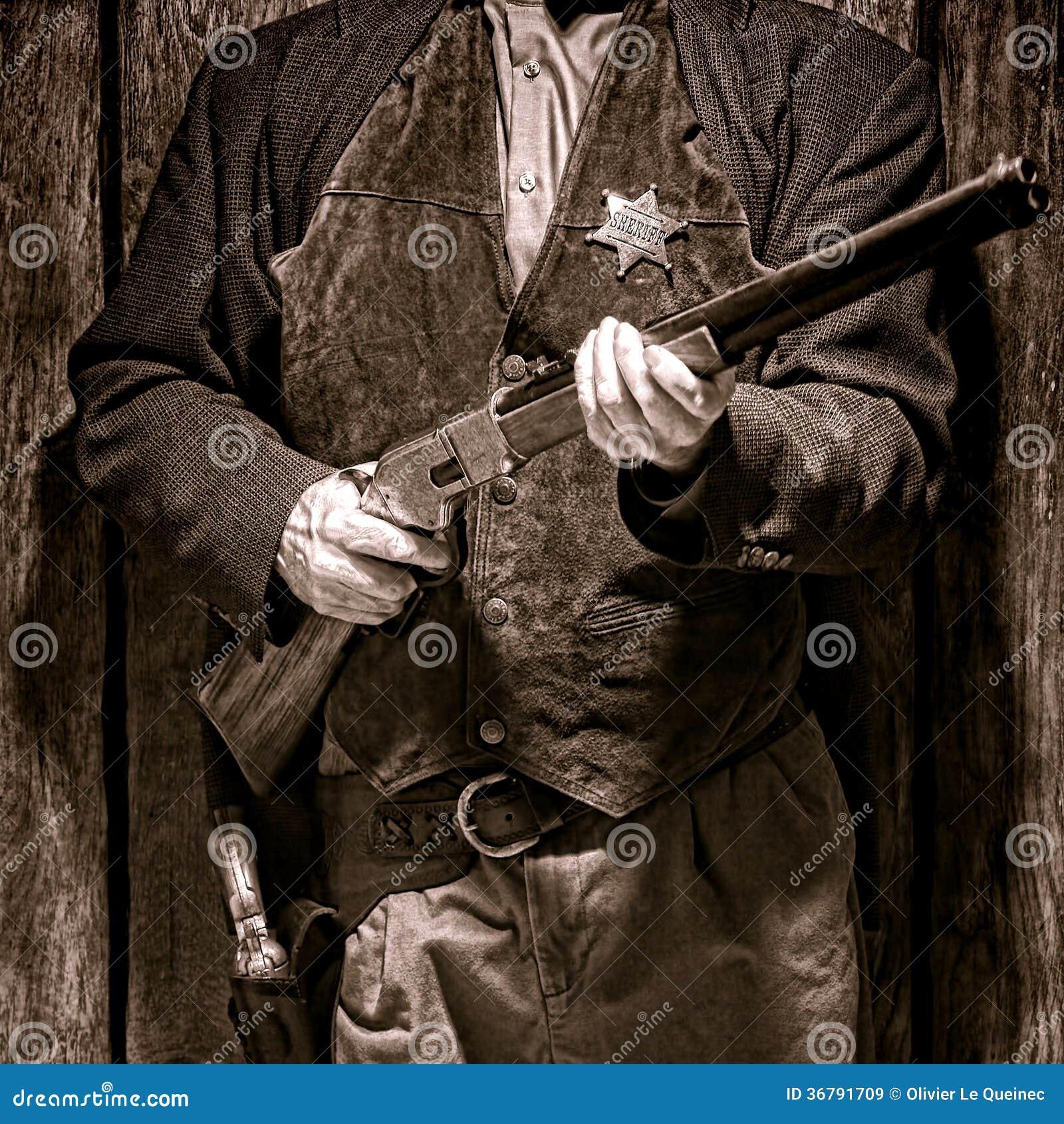 Assistant du shérif occidental américain Holding Rifle de légende