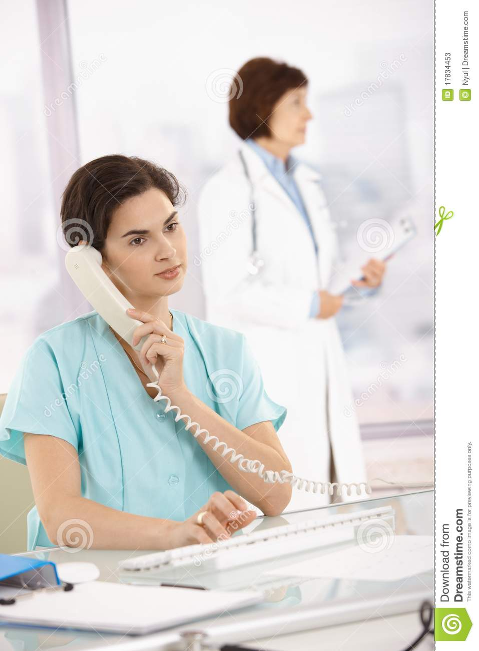 Assistant taking phone call for medical doctor