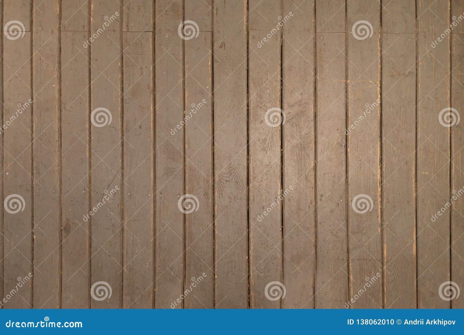 Assoalho pintado de madeira velho O assoalho é pintado cinzento e em alguns lugares é apagado