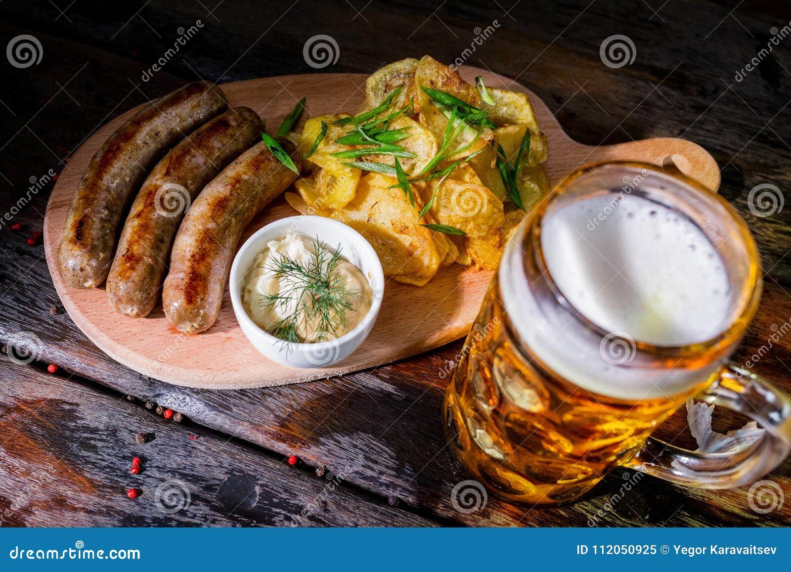 Assorted beer snacks with beer mug