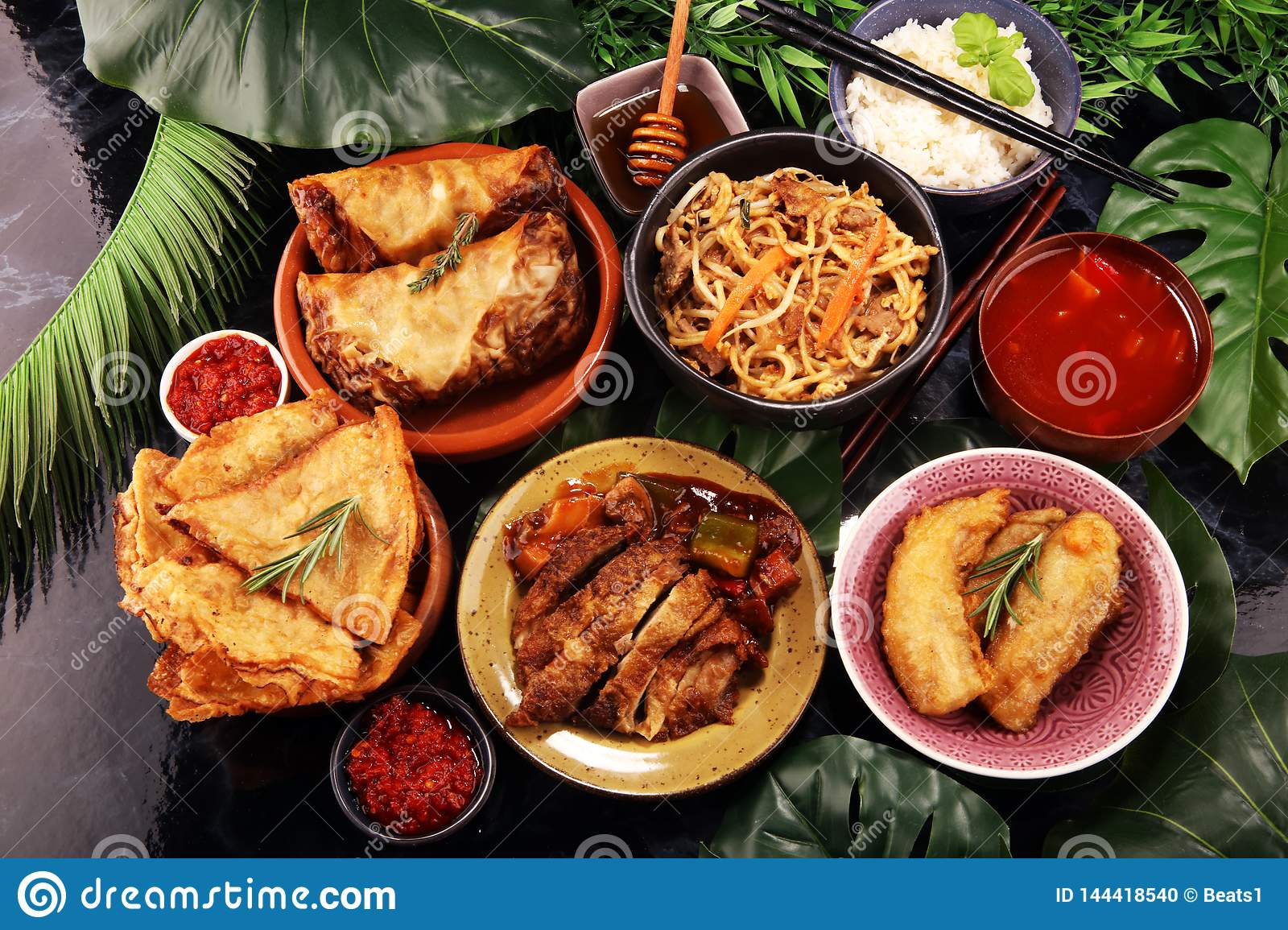 Assorted Chinese Food Set Chinese Noodles Fried Rice Peking Duck Dim Sum Spring Rolls Famous Chinese Cuisine Dishes On Table Stock Photo Image Of Noodles Vegetable 144418540