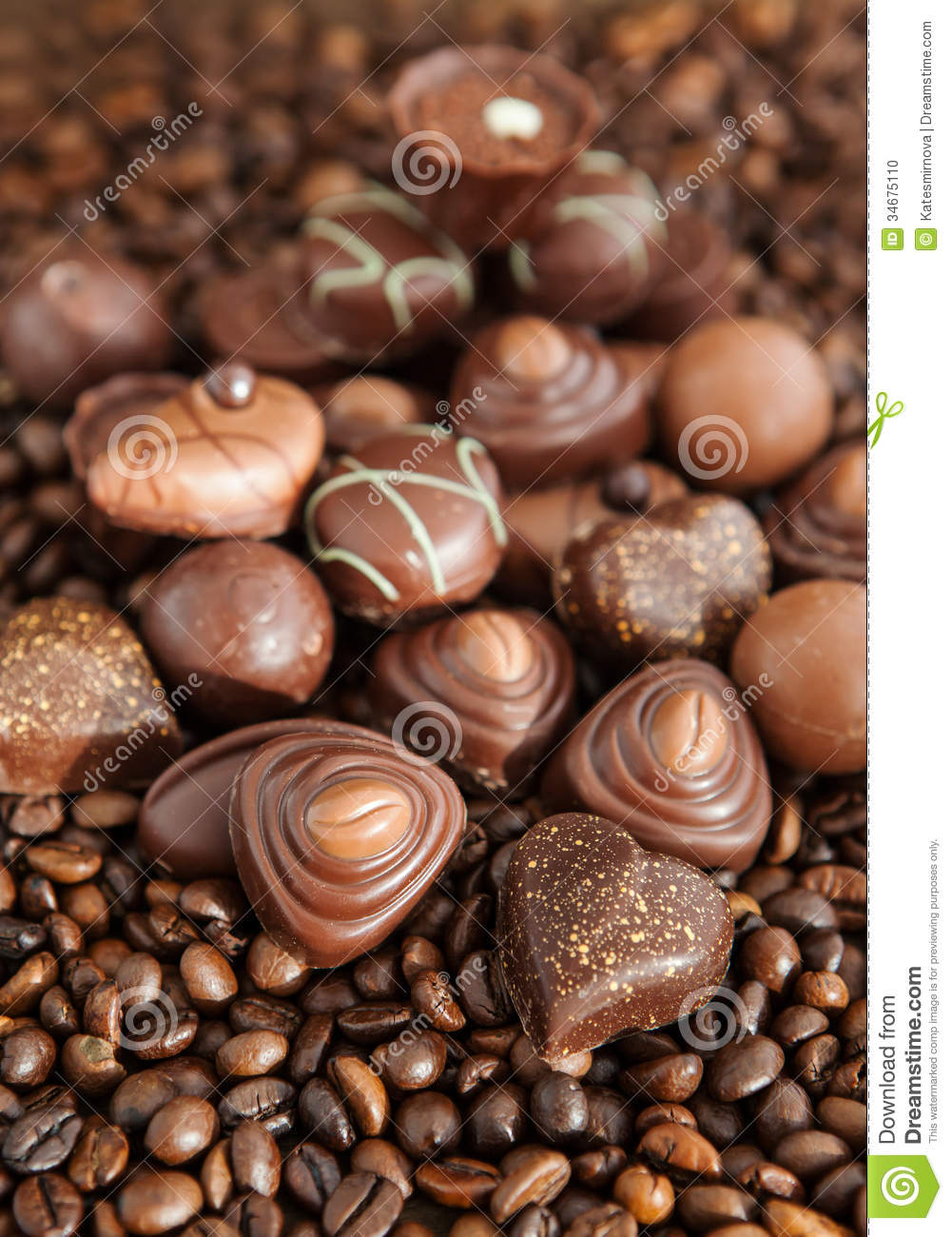 Assorted Chocolate Pralines On Coffee Beans Background Stock Photo ...