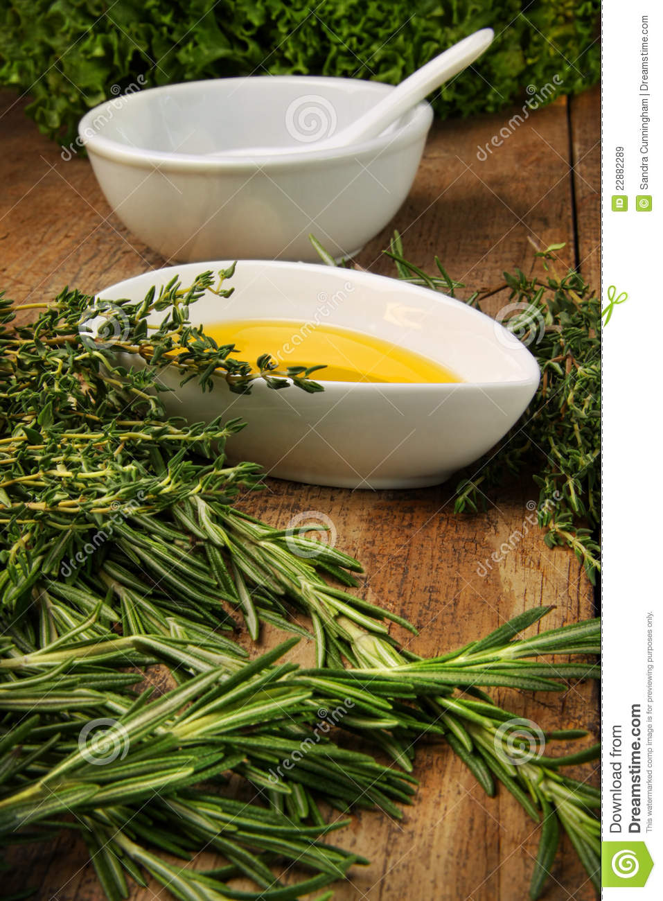 Assorted fresh herbs with olive oil