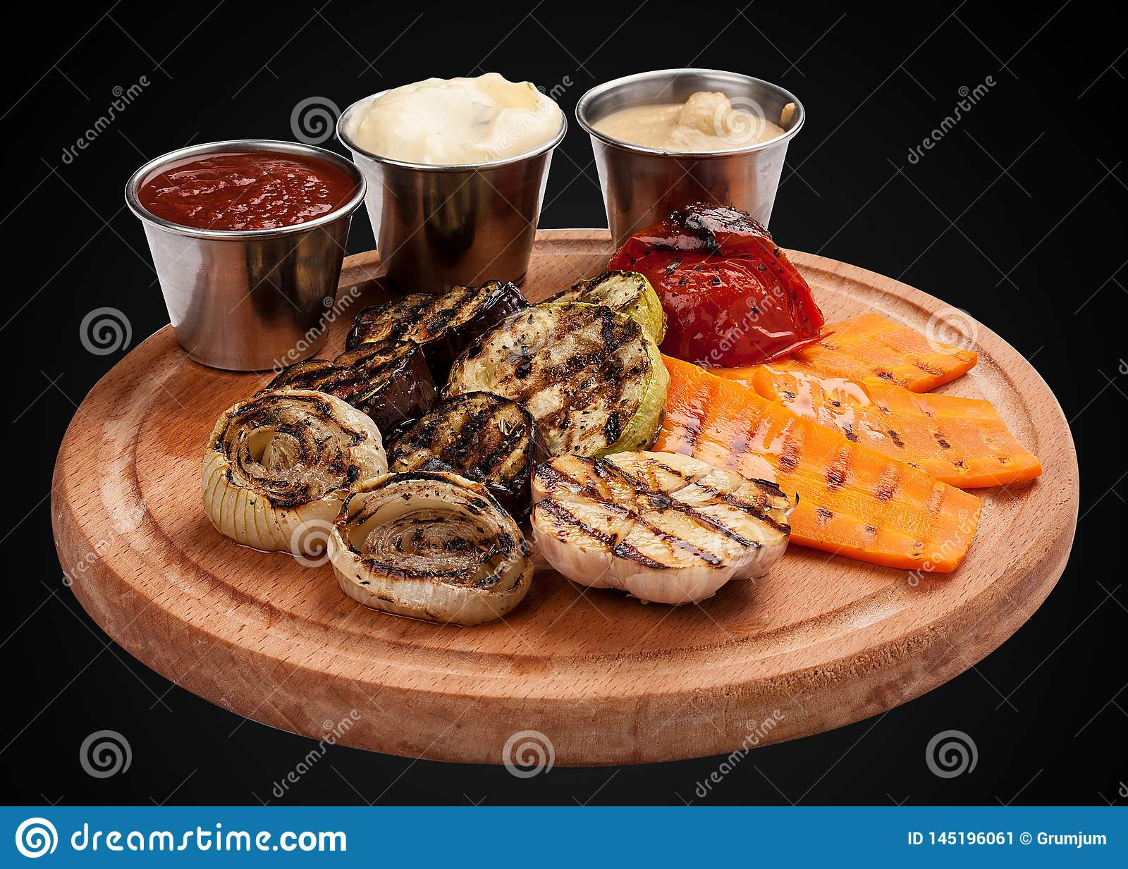 Assorted grilled vegetables on a wooden board