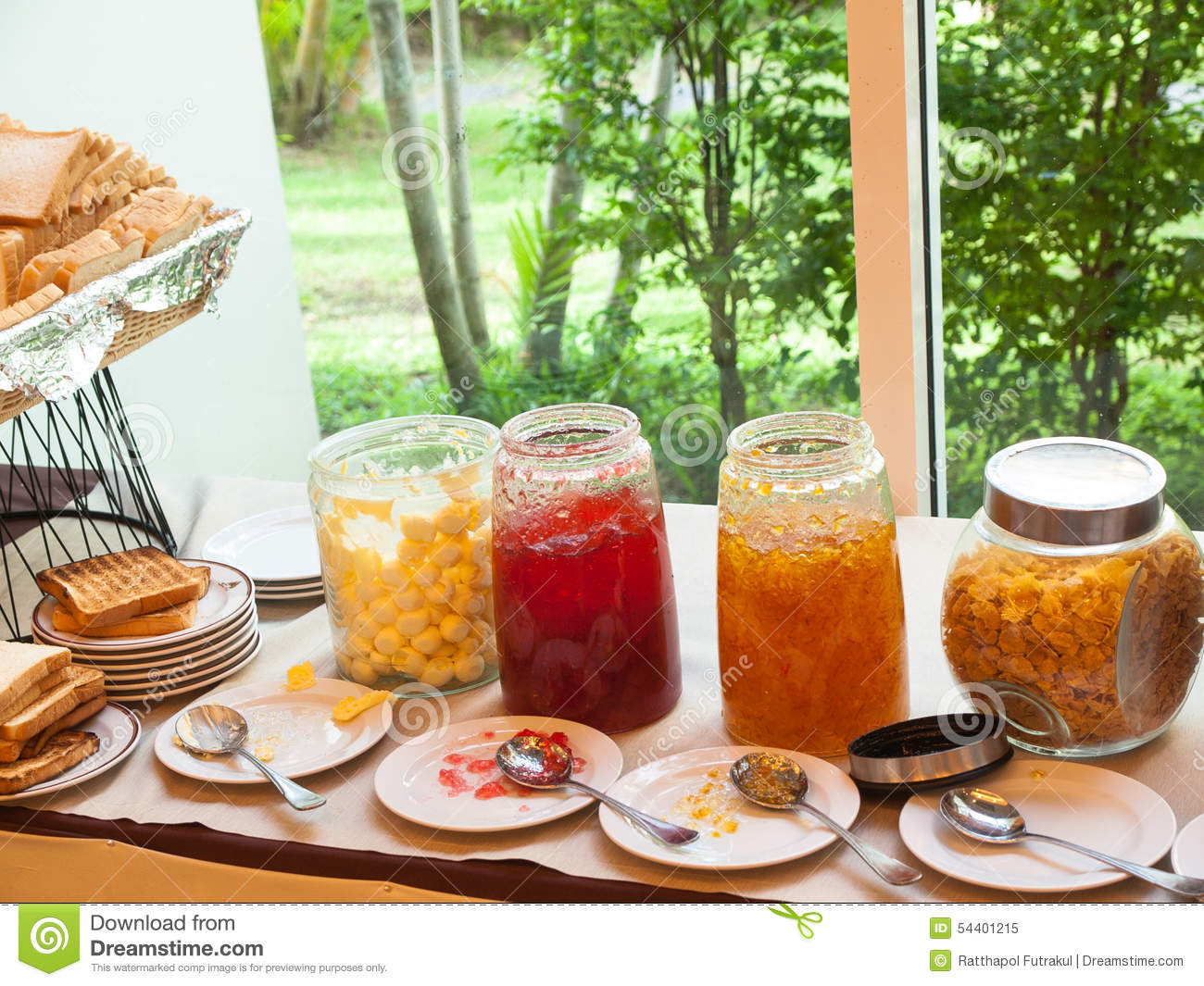 Assorted jam and butter in buffet corner stock image for Sideboard jam