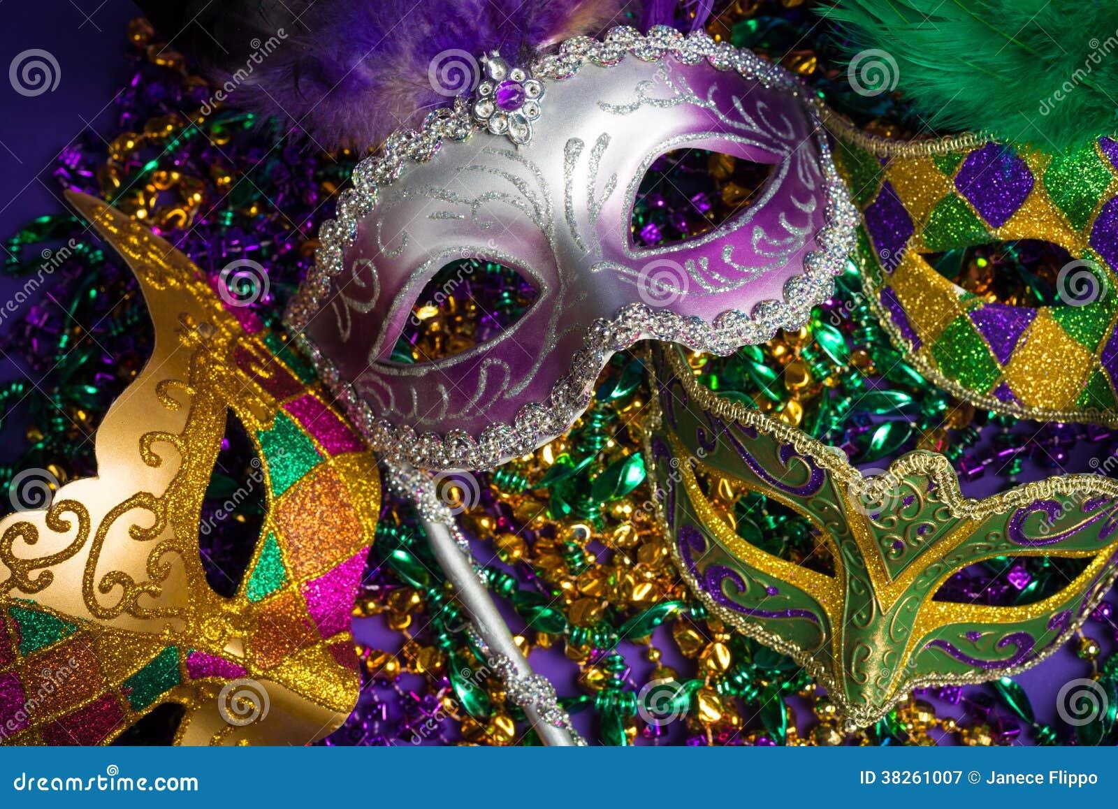 Festive Grouping of mardi gras, venetian or carnivale mask on a purple ...