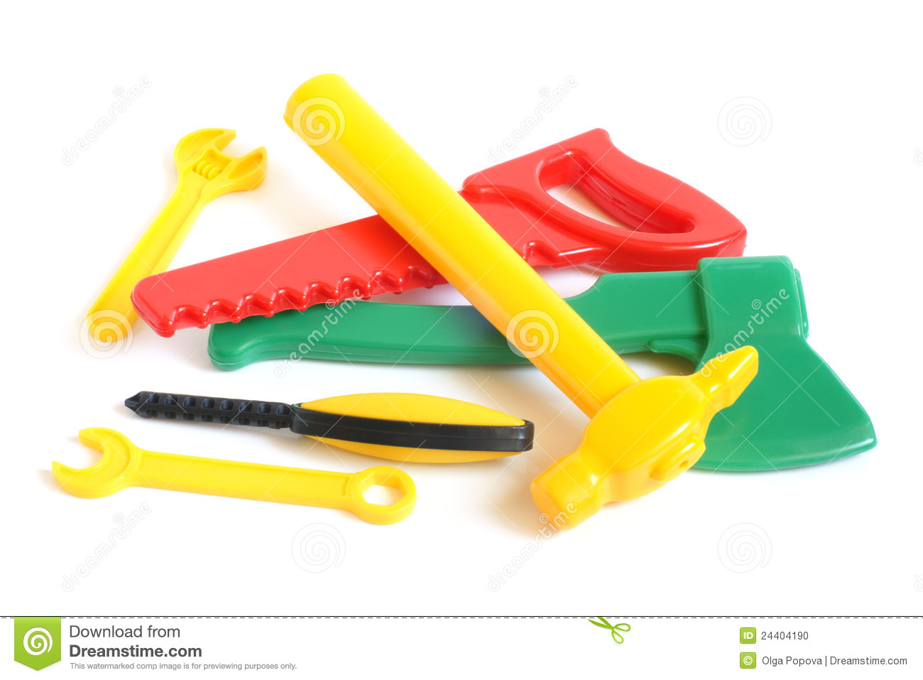 Assorted Plastic Toy On Yellow Surface: Assorted Plastic Toy Tools Stock Photo